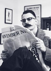 mo bro con periódico movember y bigote